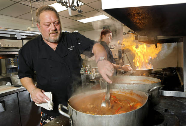 Bruce Rinehart stirs up dirty chowda for a clambake in 2013. [Oklahoman Archives]