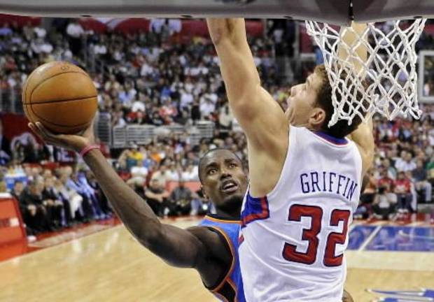 photo - Oklahoma City  Thunder  power forward Serge Ibaka, left, goes up for a shot as Los Angeles Clippers power forward Blake Griffin defends during the second half of their NBA basketball game, Wednesday, Nov. 3, 2010, in Los Angeles. The Clippers won 107-92. (AP Photo/Mark J. Terrill)
