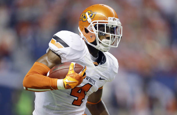 photo - Oklahoma State's Justin Gilbert returns a kick off against Texas San Antonio during the first half of an NCAA college football game, Saturday,  Sept. 7, 2013, in San Antonio. (AP Photo/Eric Gay) ORG XMIT: TXEG103