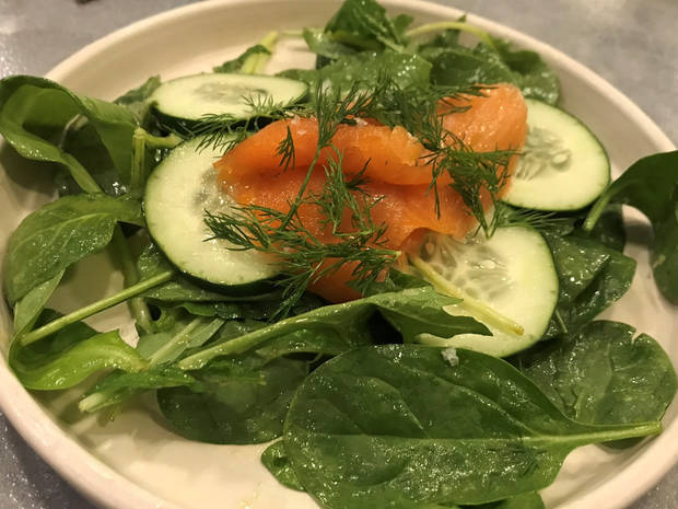 Salas with smoked salmon from Kitchen at Commonplace's new dinner service. [Dave Cathey/The Oklahoman]