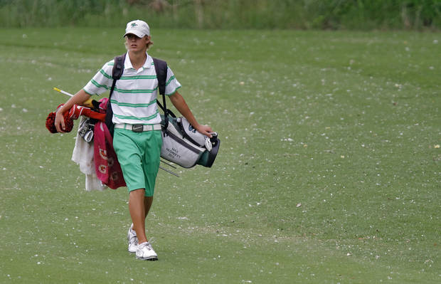 photo - Edmond Santa Fe's Max McGreevy walks the course during the 6A golf tournament at Karsten Creek on Tuesday, May 8, 2012, in Stillwater, Oklahoma. Photo by Chris Landsberger, The Oklahoman