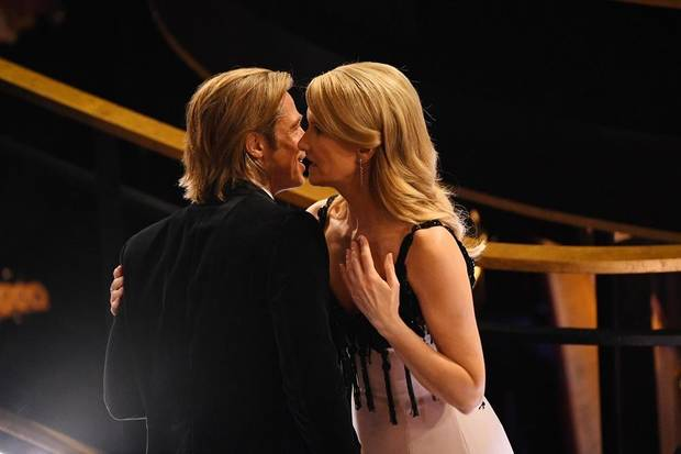 Brad Pitt and Laura Dern speak during a break in the 92nd Academy Awards at Dolby Theatre. [Robert Deutsch/USA TODAY]