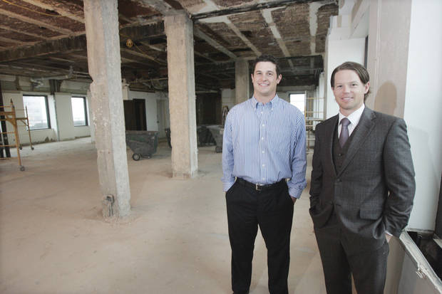 photo - Michael Nichols of Specialty Construction Services and Ran Oliver show space on the 31st floor of City Place that is being converted to living space. Photo by Steve Gooch, The Oklahoman