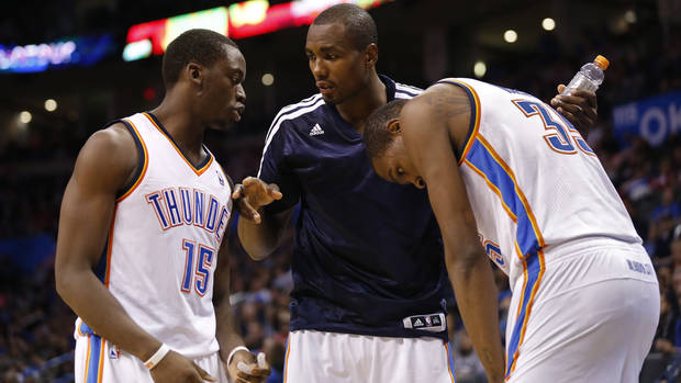 photo - Thunder's Serge Ibaka, center, tells Reggie Jackson, left, to give the ball to Kevin Durant in the second half of an NBA basketball game where the Oklahoma City Thunder were defeated 95-93 by the Brooklyn Nets at the Chesapeake Energy Arena in Oklahoma City, on Thursday, Jan. 2, 2014. Photo by Steve Sisney, The Oklahoman