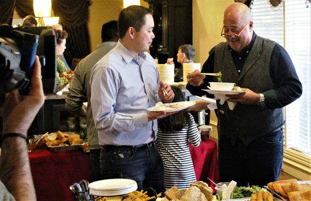 <p>Ba Luong, left, and celebrity chef Andrew Zimmern chat during a December shoot in the co-owner of Super Cao Nguyen Market's home. The episode airs Tuesday on Travel Channel. [Photo by Dave Cathey, The Oklahoman]</p>