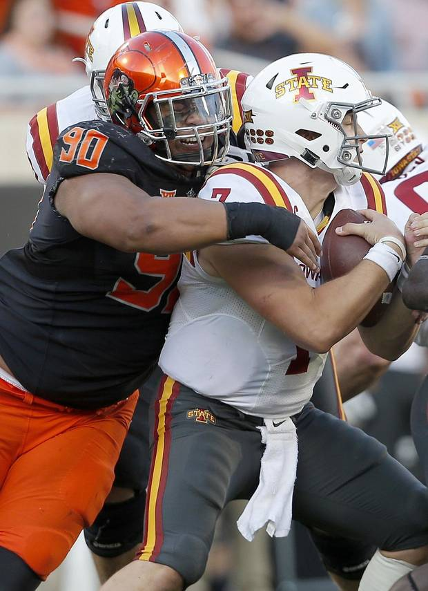 Oklahoma State's Motekiai Maile (90) celebrates a sacks Iowa State's Joel Lanning (7) in the fourth quarter during a college football game between the Oklahoma State University Cowboys (OSU) and the Iowa State University at Boone Pickens Stadium in Stillwater, Okla., Saturday, Oct. 8, 2016. Photo by Sarah Phipps, The Oklahoman