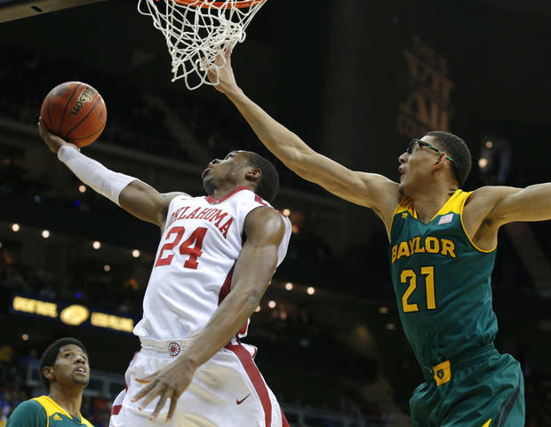 photo - Oklahoma's Buddy Hield, left, goes to the basket past Baylor's Isaiah Austin during the Big 12 Tournament Thursday.                    Photo by Bryan Terry, The Oklahoman