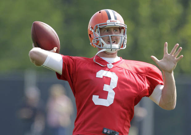 photo - FILE - This May 13, 2012 file photo shows Cleveland Browns quarterback Brandon Weeden throwing during a practice at the NFL football team's rookie camp in Berea, Ohio. Although he hasn't officially been declared Cleveland's starter, and Colt McCoy remains on the roster, Weeden will begin training camp this month as the Browns' presumptive No. 1 quarterback. (AP Photo/Amy Sancetta, File) ORG XMIT: NY151