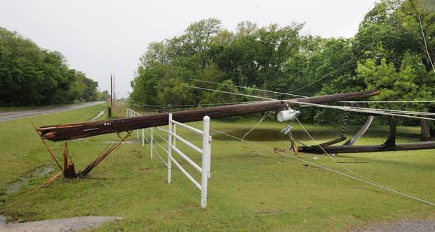 photo - A power pole along the north side of Wilshire Blvd. just east of the Sara Road intersection downed by a thunderstorm that moved through overnight in Oklahoma City Thursday, May 8, 2014. Photo by Paul B. Southerland, The Oklahoman