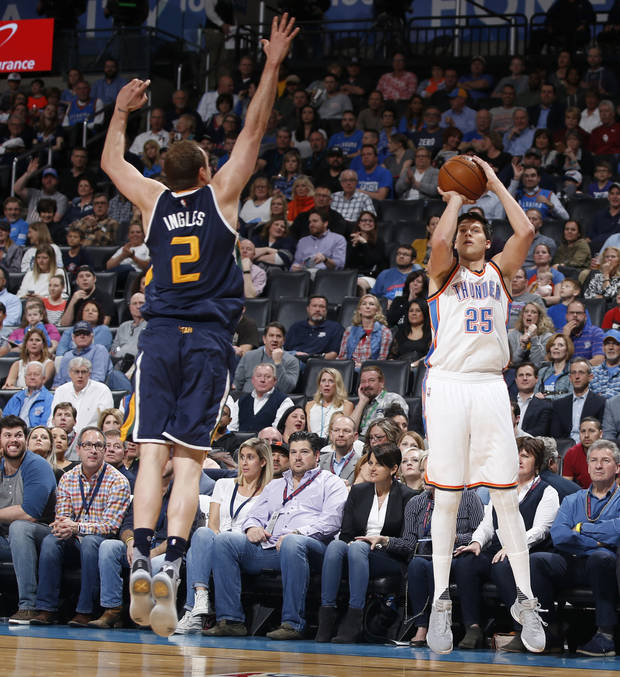 Doug McDermott shoots over Utah's Joe Ingles in a game last season. (Photo by Bryan Terry)
