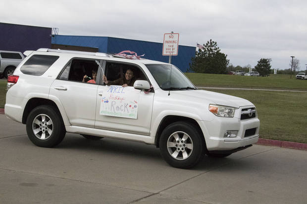 "One of the vehicles involved in the parade points out, correctly, that ""April birthdays rock."""