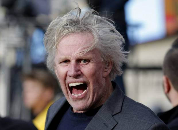 Actor Gary Busey cheers from the sidelines during a college football game between Oklahoma State and West Virginia at Boone Pickens Stadium in Stillwater, Okla., Saturday, Nov. 17, 2018. [Sarah Phipps/The Oklahoman Archives]