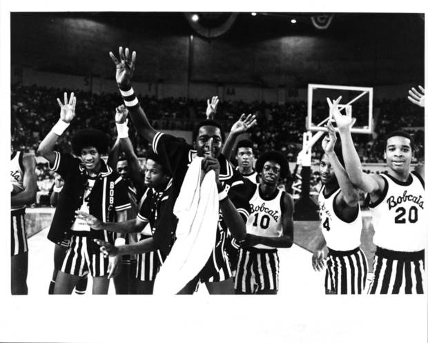 photo - Star Spencer players celebrate winning the Class 3A title on March 11, 1979. It was the team's fourth straight championship.  PHOTO BY STEVE GOOCH, THE OKLAHOMAN ARCHIVE