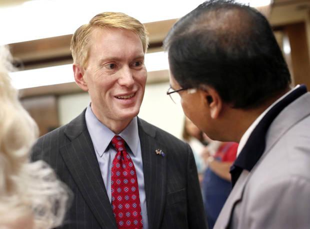 photo - James Lankford talks to a guest after his debate with two other Republican candidates for a US Senate seat on Wednesday,   April 16, 2014. Photo by Jim Beckel, The Oklahoman