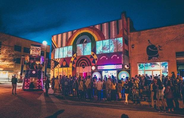 "People line up for the opening of Phase 1 of Factory Obscura's new immersive art attraction ""Mix-Tape at The Womb"" in March. The OKC artist collective is opening Phase 2 of ""Mix-Tape"" Sept. 21. [Todd E. Clark]"