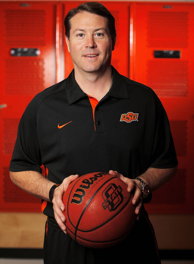 photo - OSU head men's basketball coach Travis Ford poses for a photo during basketball media day for Oklahoma State University at Gallagher-Iba Arena in Stillwater, Okla., Monday, Oct. 22, 2012. Photo by Nate Billings, The Oklahoman