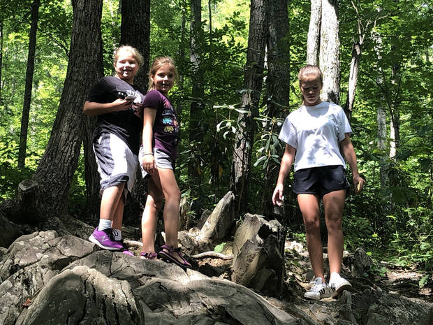 Sisters Sadie (left), Tinley (center) and Riley Argyle climb rocks in Great Smoky Mountains National Park. (Photo by Berry Tramel)