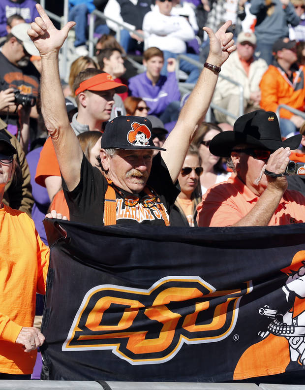 Cowboy fan Cliff Lowery from Wannette celebrates a touchdown during the second half of a college football game between the Oklahoma State University Cowboys (OSU) and the TCU Horned Frogs at Amon G. Carter Stadium in Fort Worth, Texas, on Saturday, Nov. 19, 2016. Photo by Steve Sisney, The Oklahoman
