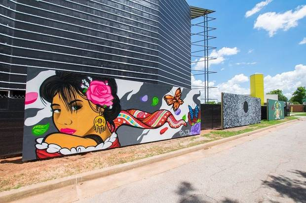 "Sergio ""Tank"" Ramirez was among the Oklahoma artists to create the first set of murals in the ""Making Space: Summer Mural Series,"" on view through Labor Day weekend along the construction fence at the new site of Oklahoma Contemporary Arts Center, NW 11 and Broadway [Brandon Seekins photo]"