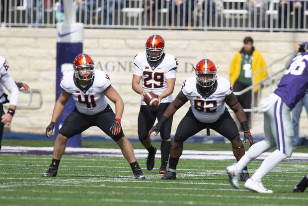 OSU kicker Zach Sinor prepares to punt during the first half of Saturday's game in Manhattan, Kansas. [PHOTO BY BRUCE WATERFIELD, Courtesy OSU Athletics]