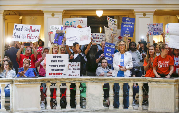 Teachers and supporters of increased education funding rally on the fourth floor of the Oklahoma state Capitol during a continuing walkout by Oklahoma teachers in Oklahoma City, Monday, April 9, 2018. (Nate Billings/The Oklahoman via AP)