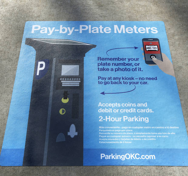 Sidewalk decals will help motorists make the transition to new electronic parking meters in downtown Oklahoma City. [Photo by Jim Beckel, The Oklahoman]