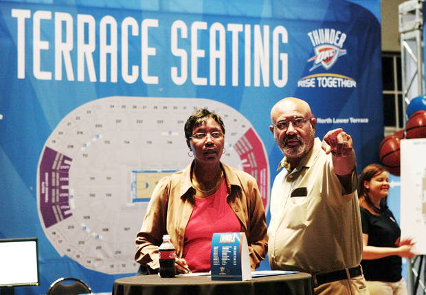 photo - Judie, left, and Thomas Hanes drove from Altus to upgrade their Thunder season tickets Friday. Photo by Jim Beckel, The Oklahoman