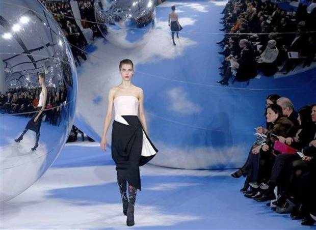 photo - A model wears a creation by designer Raf Simons for Christian Dior's Ready to Wear Fall-Winter 2013-2014 fashion collection, presented, Thursday, March.1, 2013 in Paris. (AP Photo/Jacques Brinon)