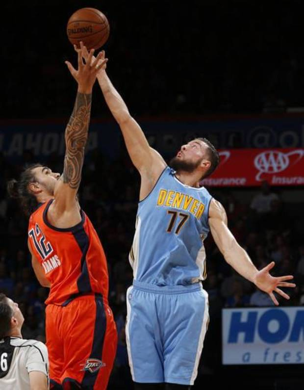 Joffrey Lauvergne and Steven Adams battle for a jump ball during a Thunder-Nuggets game last season. (Photo by Sarah Phipps)