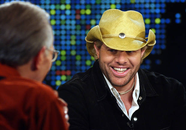 "OKLAHOMA NATIVE: County music star Toby Keith shares a light moment with Larry King during an interview on CNN's ""Larry King Live,"" Wednesay, Jan. 21, 2004, in the Hollywood section of Los Angeles. Among other things, Keith spoke about his meteoric rise in country music over the past few years since the release of several patriotic songs supporting the country and America's military. (AP Photo/CNN, Rene Macura)"