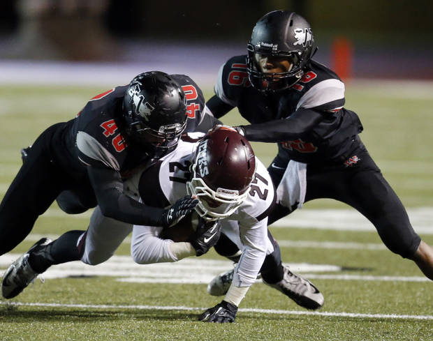 photo - Westmoore's Denver Beebe (40) and Jaylen Bennett (16) combine to bring down Jenks' Tye Brett in high school football on Friday, Oct. 18, 2013 in Moore, Okla.  Photo by Steve Sisney, The Oklahoman