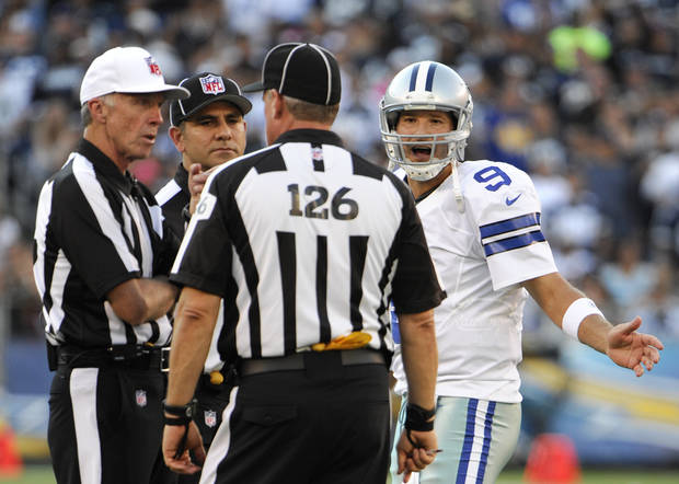 photo - Dallas Cowboys quarterback Tony Romo pleads his case with officials during the first half of a NFL preseason football game against the San Diego Chargers Saturday, Aug. 18, 2012 in San Diego. (AP Photo/Denis Poroy) ORG XMIT: CALI120