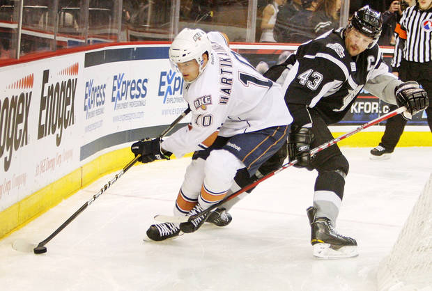 photo - Oklahoma City's Teemu Hartikainen (10) skates away from San Antonio's Nolan Yonkman (43) in the second period during the AHL hockey game between the Oklahoma City Barons and the San Antonio Rampage at the Cox Convention Center in Oklahoma City, Thursday, Feb. 2, 2012. Photo by Nate Billings, The Oklahoman