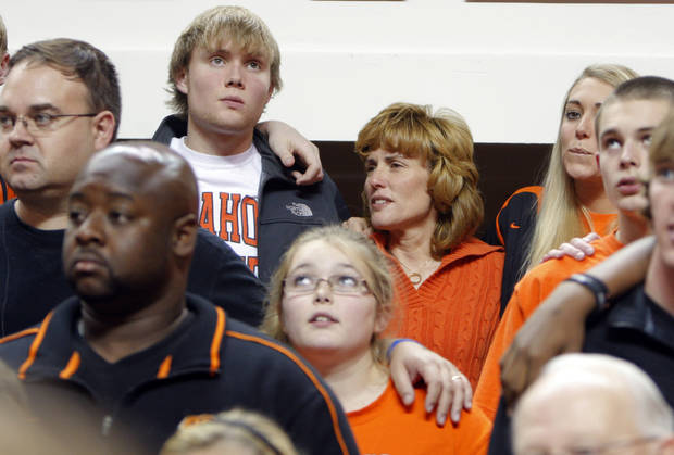 photo - Alex and Shelley Budke sing the Alma Mater during the women's college game between Oklahoma State University and Coppin State at Gallagher-Iba Arena in Stillwater, Okla.,  Saturday, Nov. 26, 2011.  Photo by Sarah Phipps, The Oklahoman