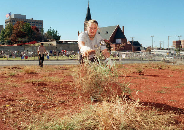 Oct. 29, 1996: Lisa Perkins of Concord, Ohio, clears weeds from the empty lot just north of the Alfred P. Murrah Federal Building explosion site in downtown Oklahoma City. Perkins was part of the National Civilian Community Corps Sun Team No. 1, a group that is part of the NCCC out of Denver, Colo., provided through the AmeriCorps program. [Photo by Roger Klock, The Oklahoman]