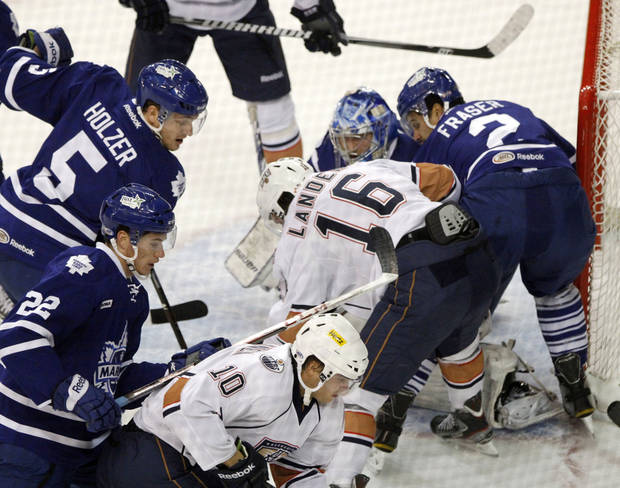 photo - OKLAHOMA CITY BARONS / AHL HOCKEY: OKC Barons and Toronto Marlies get bunched up at the goal during Field Trip Day with the Barons Hockey at the Cox Convention Center in Oklahoma City, OK, Tuesday, November 13, 2012,  By Paul Hellstern, The Oklahoman
