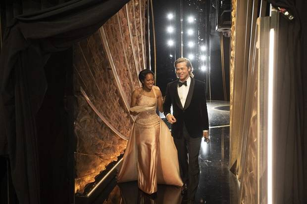 Brad Pitt walks with Regina King after he won the Oscar for Best Supporting Actor backstage during the 92nd Academy Awards at Dolby Theatre. [Handout Photo by AMPAS via USA TODAY NETWORK]