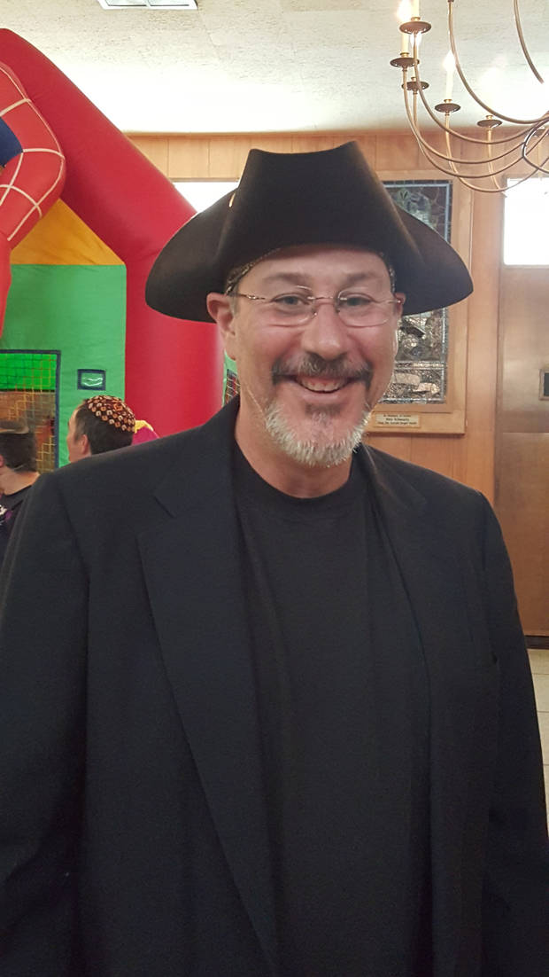 Jeff Goss, Emanuel Synagogue's director of youth education, dressed as Haman, the villain in the Purim story, during the synagogue's recent Purim festivities in Oklahoma City. [Photo by Carla Hinton, The Oklahoman]