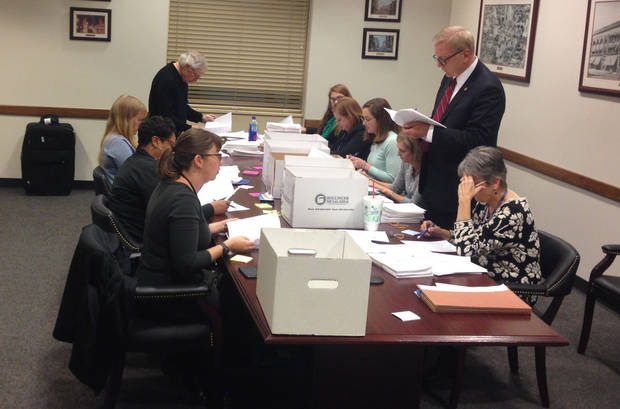 Staff from Oklahoma City's municipal counselor's office and clerk's office began reviewing signature pages for a teacher pay raise initiative on Nov. 9. [The Oklahoman file]