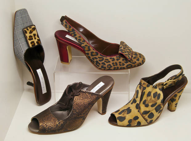 "photo - Be ready to prowl the town with leopard and snakeskin prints (Silvy II mule, $325; Rowena 1893 slingback, $345; ""84,"" $345; and Orly, $345; all from Olivia Rose Tal. (MCT)"