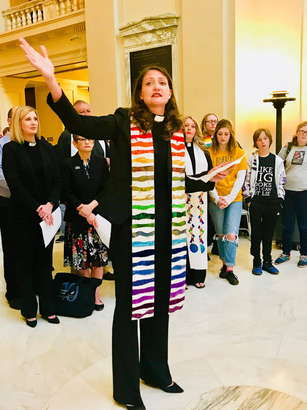The Rev. Lori Walke, associate pastor of Mayflower Congregational Church UCC, offers a blessing for teachers and support staff during a prayer gathering on Thursday at the State Capitol. [Photo by Carla Hinton, The Oklahoman]