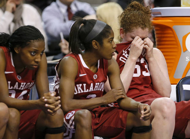 photo - Oklahoma's Joanna McFarland (53), at right, wipes her eyes beside Aaryn Ellenberg (3) and Sharane Campbell (24), at left, during the Big 12 tournament women's college basketball game between the University of Oklahoma and Iowa State University at American Airlines Arena in Dallas, Sunday, March 10, 2012.  Oklahoma lost 79-60. Photo by Bryan Terry, The Oklahoman