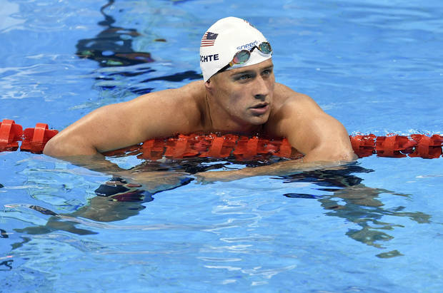 FILE - In this Aug. 9, 2016, file photo, United States' Ryan Lochte checks his time after a men' 4x200-meter freestyle relay heat during the swimming competitions at the 2016 Summer Olympics in Rio de Janeiro, Brazil. The father of the American swimmer said Wednesday, Aug. 17, his son arrived back in the United States before a Brazilian judge ordered that Lochte stay in Brazil as authorities investigate a robbery claim involving the athlete during the Olympics. (AP Photo/Martin Meissner, File)