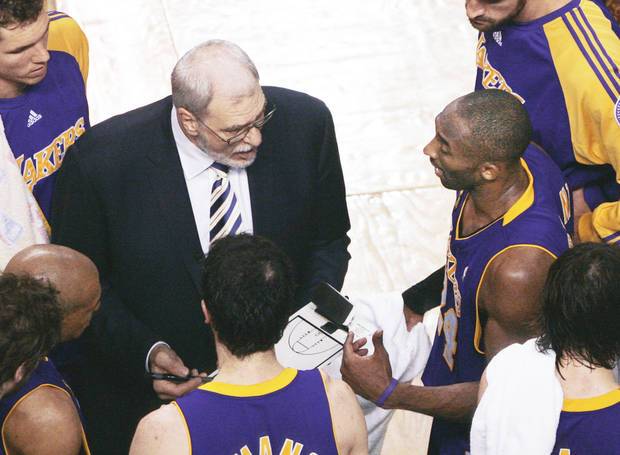 photo - Los Angeles Lakers head coach Phil Jackson, left, could certainly be considered one of the best NBA coaches ever. But, were his choices of coaching jobs picked for success? AP photo