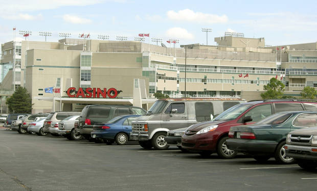 photo - A full parking lot is seen in this file photo outside the Remington Park casino in Oklahoma City. Photo by STEVE LACKMEYER, the Oklahoman