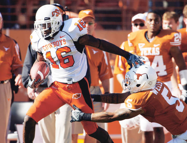 photo - Cornerback Perrish Cox, left, is the only returning starter for Oklahoma State in the defensive backfield.  Photo by Steve Sisney, The Oklahoman