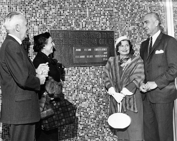 A plaque is unveiled at the dedication of the new Oklahoma Art Center Dec. 5, 1958. Located at the building's entrance on Plaza Circle at the OKC Fairgrounds, the plaque honors the couple who donated $250,000 to build the art center: Mr. and Mrs. John E. Kirkpatrick, right. At left are Mr. and Mrs. Dave Price; Price was chairman of the dedication day program. [The Oklahoman Archives]