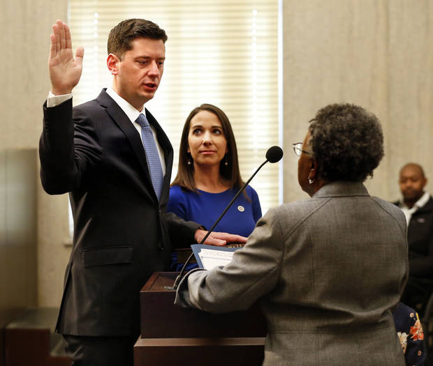 Former City Councilwoman Willa Johnson administered the oath of office as David Holt was sworn in as Oklahoma City's 36th mayor on Tuesday. Holt's wife, Rachel, held a family Bible for the ceremony. [Photo by Steve Sisney, The Oklahoman]