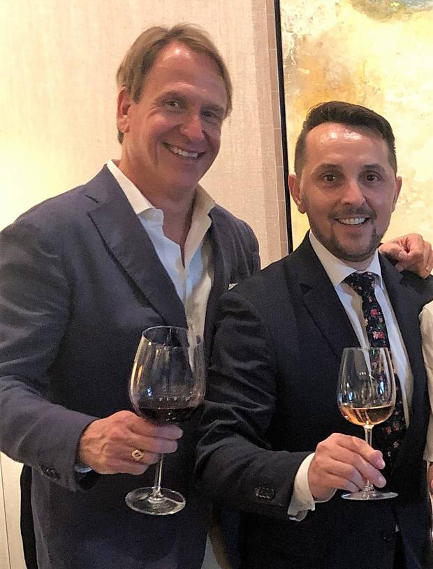 Enis Mullaliu, right, raises a glass with Scott Witherby of Premium Brands Wine and Spirits at a farewell dinner at Vast last week.