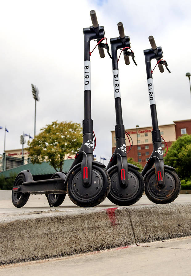 Bird Scooters are parked along the a Bricktown sidewalk in downtown Oklahoma City, Okla. on Tuesday, Aug. 14, 2018. The city council will consider cracking down on electric rental scooters parked in the public right of way. Photo by Chris Landsberger, The Oklahoman